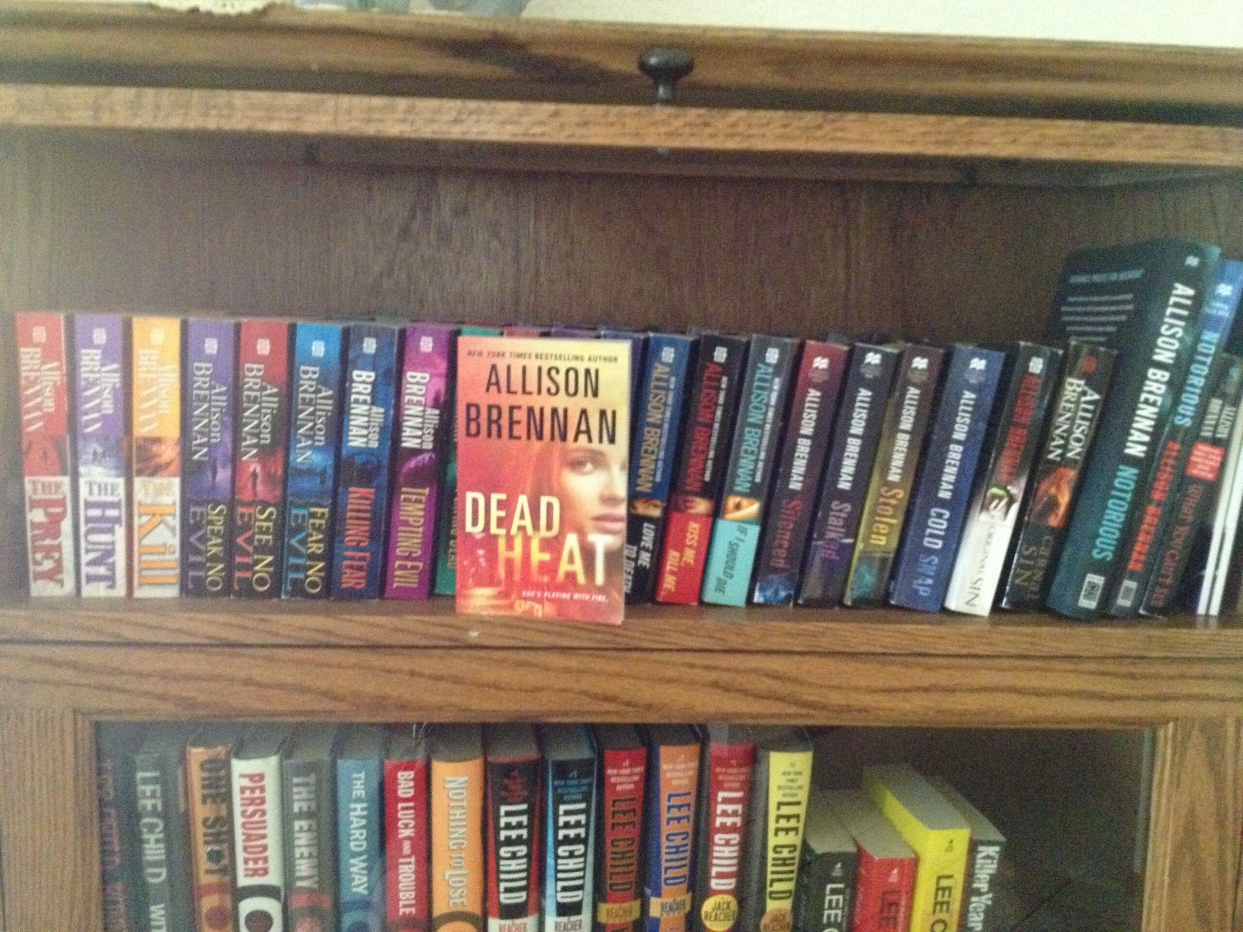 I have my own shelf in a special bookcase! See who's on the shelf below me? My mom's other favorite author!